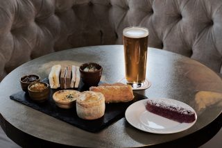 Sandwiches and sweet treats but make it suave.   Our Gentleman's Afternoon Tea includes a range of sandwiches, a luxury sausage roll, goat's cheese & red onion quiche, a fresh cheese scone, a mint chocolate thin & half a pint of lager.  To book please state at the time of booking.   Book on 017687 76551.  #armathwaitehall #afternoontea #indoordining #lakedistrict #lakedistrictuk