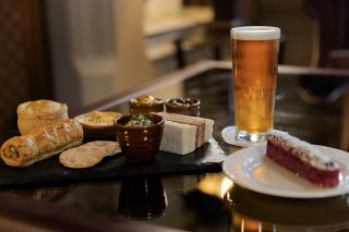 Feeling like afternoon tea with a twist?  Our Gentleman's Afternoon Tea includes a range of sandwiches, a luxury sausage roll, goat's cheese & red onion quiche, a fresh cheese scone, a mint chocolate thin & half a pint of lager.  To book please state at the time of booking.   Book today via the link in our bio or call 017687 76551.  #armathwaitehall #afternoontea #indoordining #lakedistrict #lakedistrictuk